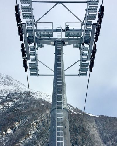 Low Angle View Of Ski Lit Tower On Snowcapped Mountain