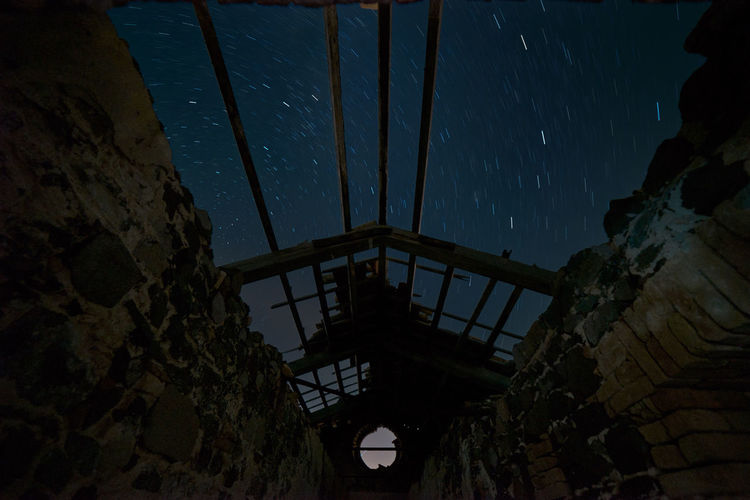 night sky view from the collapsed roof of the old semaphore of capo sperone (sant Antioco) Ceiling Abandoned Architecture Astronomy Building Built Structure History Lights And Shadows Low Angle View Nature Night Nightscape Nightsky No People Old Outdoors Ruined Sky Space Star Star - Space Startrails The Past My Best Travel Photo