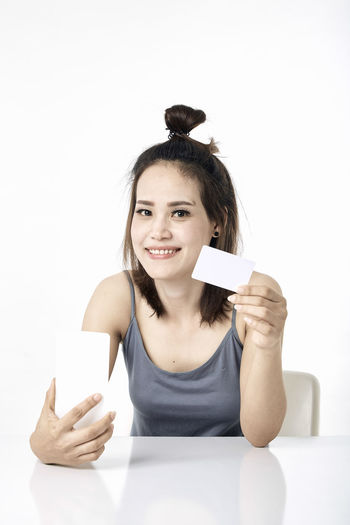Thai Studio Shot 30-34 Years Shopping Online  Young Female Happy Asian  Laptop Beautiful Internet Attractive Smile person Computer People Portrait Holding Phone Beauty Mobile Pretty Technology Payment Adult Using Lifestyle Cheerful Purchase Business Wireless Lady Chinese Fashion Looking Smartphone Japanese  Korean Credit Card Empty Text Copy Space One Person White Background Smiling Looking At Camera Front View Indoors  Communication Young Adult Happiness Waist Up Young Women Emotion Gesturing Casual Clothing Teeth Wireless Technology Hairstyle