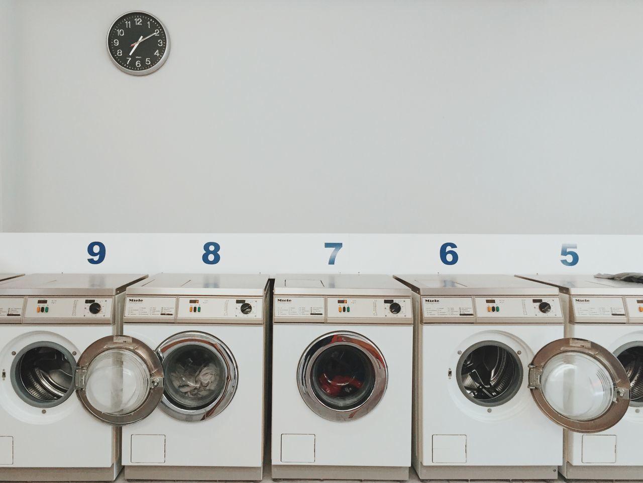 Washing machines against wall