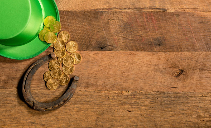 Gold coins for luck as an illustration for St Patrick's day with horsehose and green hat Gold Green Color Horseshoe Luck Luck Of The Irish Lucky Rustic St Patrick's Day Wooden Table Gold Coin Gold Coins Green Hat Overflowing St Patrick Top Hat Wood - Material