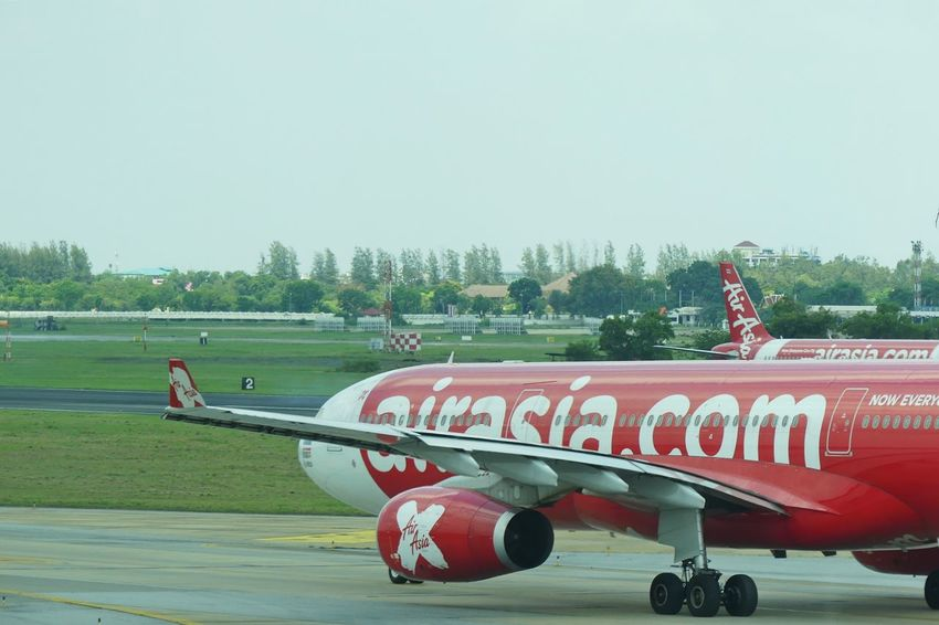 Bangkok, THAILAND - April 14, 2017 : Air asia X Taxi on runway at Don Mueang International Airport on April 14, 2017. Air asia is a major domestic low-cost airline in Thailand. Air Asia Air Asia X Air Vehicle Airplane Airport Airport Runway Airportphotography Bangkok Airport Bangkok Thailand. Clear Sky Day Mode Of Transport Nature No People Outdoors Red Runway Sky TakeOff Thai Air Asia Thai Airline Thai Airline Passenger Thai Airport Transportation Tree