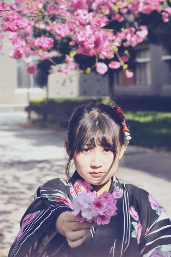 Flower One Person Waist Up Focus On Foreground One Girl Only Outdoors Building Exterior Real People Childhood Looking Down Fragility Portrait Flower Head People Nature Close-up