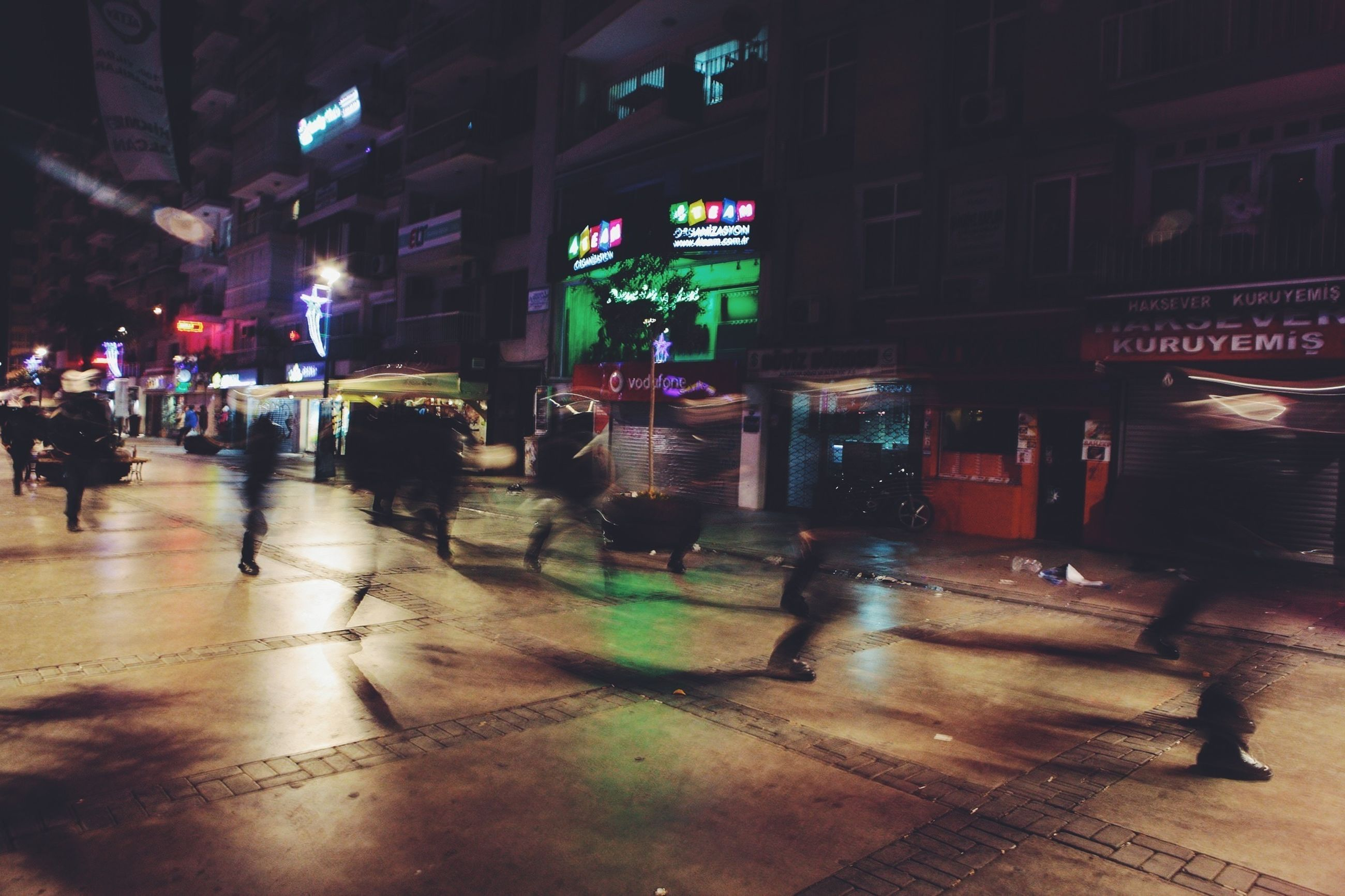 illuminated, night, city, city life, building exterior, street, architecture, built structure, transportation, large group of people, city street, person, men, walking, car, land vehicle, incidental people, road, lifestyles
