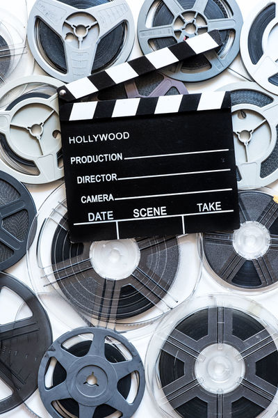 Movie clapper board on super 8 movie reel background Arts Culture And Entertainment Backgrounds Clapper Clapper Board Close-up Communication Day Film Film Industry Indoors  MOVIE No People Reel Super 8 Technology Text The Media