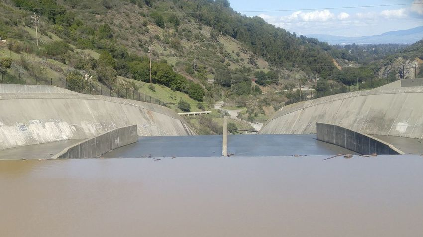 Reservoir Architecture Sky Beauty In Nature Outdoors Nature No People Water Tree Built Structure Day Cement Spillway Slope Flowing Flowing Water Backgrounds System Falling