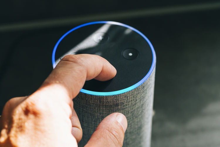 Close-up of person touching bluetooth speaker