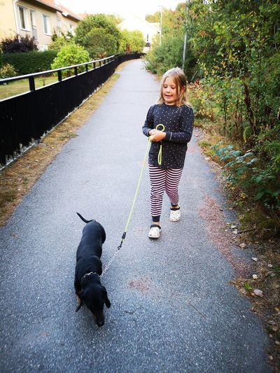 Happy! My daughter love all animal. We found this dog and Thanks to internet he got home to his owner. No Edit/no Filter Huaweiphotography Leicacamera Real People Sweden Pets Full Length Child Dog Childhood Portrait Standing Smiling Pet Leash Water