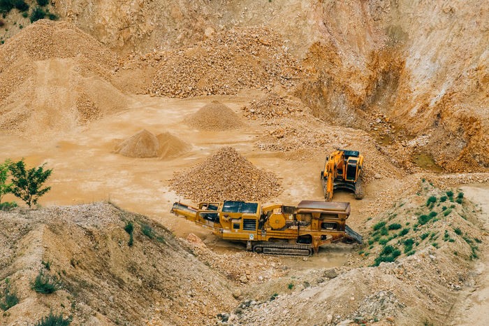 Minerals Bulldozer Construction Industry Construction Machinery Construction Site Construction Vehicle Dirt Earth Mover Environment Geology Industry Land Land Vehicle Machinery Mine Mining Mode Of Transportation Outdoors Quarry Road Stone Surface Mine Transportation Truck Vehicle