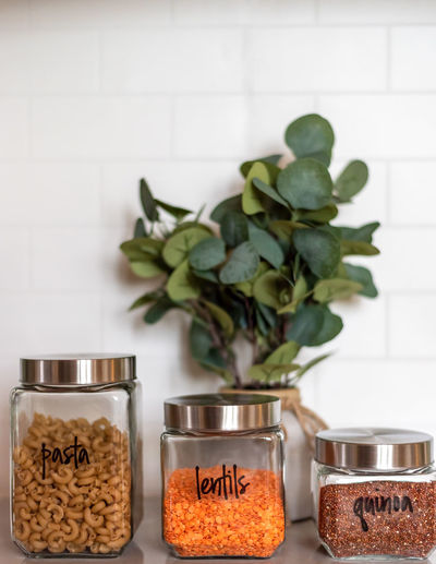 Close-up of potted plants in jar on table