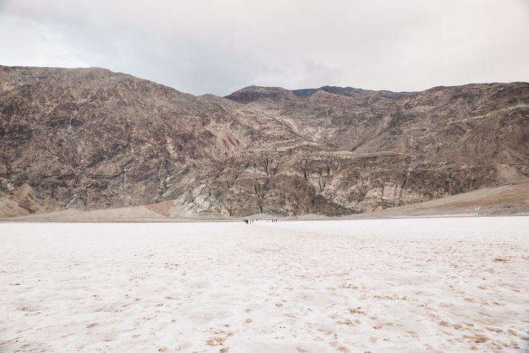 Arid Climate Arid Landscape Badwater Basin Beauty In Nature Day Death Valley Death Valley National Park Death Valley, California Desert Desert Landscape Landscape Mountain Mountain Range Nature No People Outdoors Salt Salt - Mineral Salt Flat Scenics Sky Tranquil Scene Tranquility