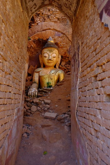 Buddha Submerged in Rubble inside previous Buddhist Temple (11th to 13th century) Ancient History Ancient Ruins Architectural Ruins Brick Walls Buddha Buddha Statue Buddhism Buddhism Culture Buddhist Architecture Buddhist Pagoda Buddhist Temple Composition Full Frame Illuminated Indoor Photography Inle Lake Kakku Myanmar Old Ruins Place Of Worship Religion Shan State Tourism Tourist Attraction  Tourist Destination