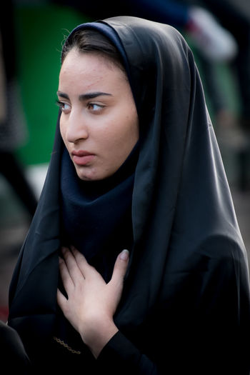 Heartfelt. Ashura Beautiful Woman Close-up Day Focus On Foreground Front View Hands Clasped Heartfelt Hijab Iran Lifestyles One Person Outdoors People Real People Sitting Traditional Clothing Veil Women Young Adult Young Women EyeEmNewHere