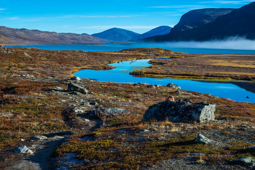 September hiking along The King's Trail in northern Sweden Alesjaure  Autumn Blue Day Hiking Idyllic Kungsleden Lake Mountain Mountain Range Nature No People Non-urban Scene Northern Europe Path Remote Rock Formation Rocky Scandinavia September Sweden The Kings Trail Tourism Trail Water