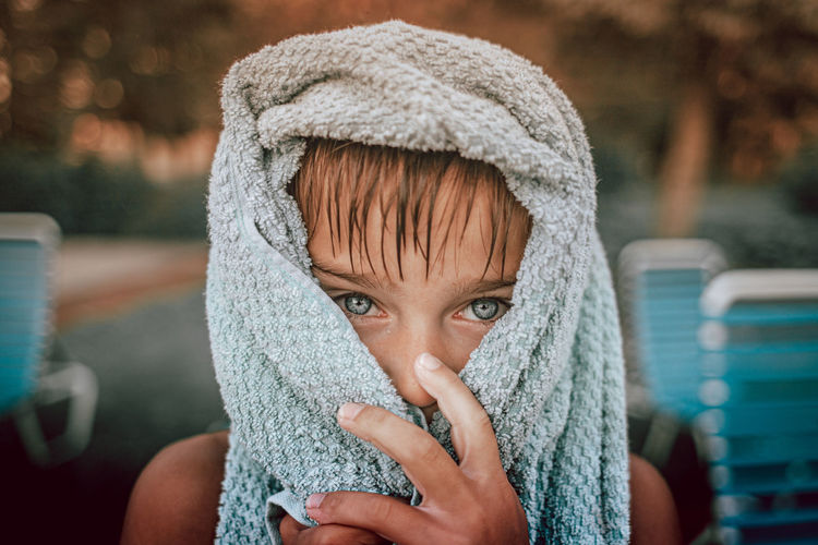 Close-up portrait of boy in beach towel