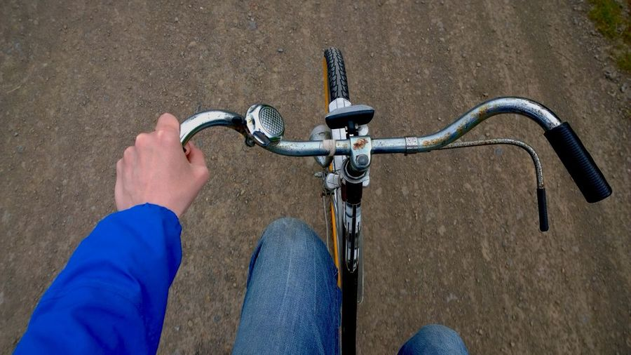 Hand of cyclist on handlebar