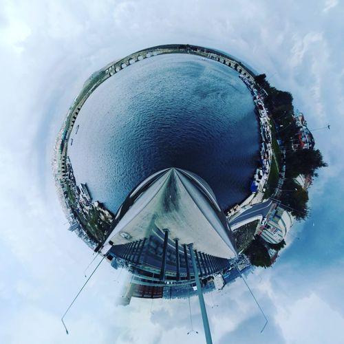 Digital composite image of ferris wheel against sky
