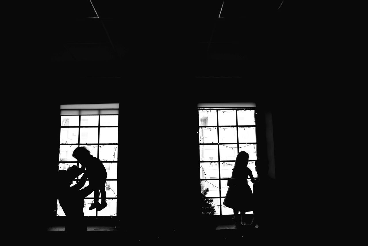 window, real people, indoors, silhouette, men, walking, built structure, day, two people, architecture, standing, full length, adult, people