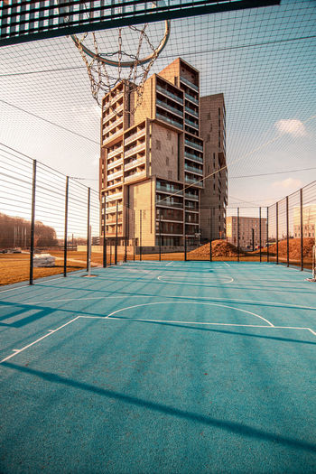 View of basketball court against building