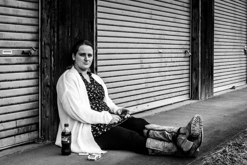 Smoking Storage Unit Adult Black And White Blackandwhite Cigarette  Cowboy Boots Day One Person Outdoors Sitting Soft Drink Street Streetphotography Young Women