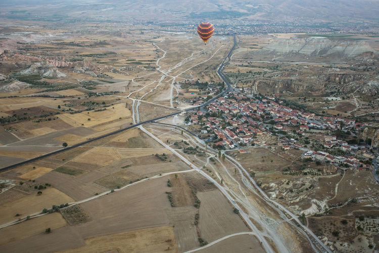 Aerial view of hot air balloon over city