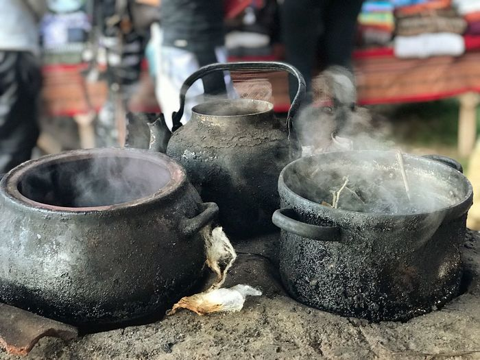 Natural Colors Wood Stove Natural Fiber Tie Indigenous People Colors Food And Drink Food Focus On Foreground Steam No People Drink Day Cooking Utensil Outdoors Camping Stove Freshness Heat - Temperature EyeEmNewHere
