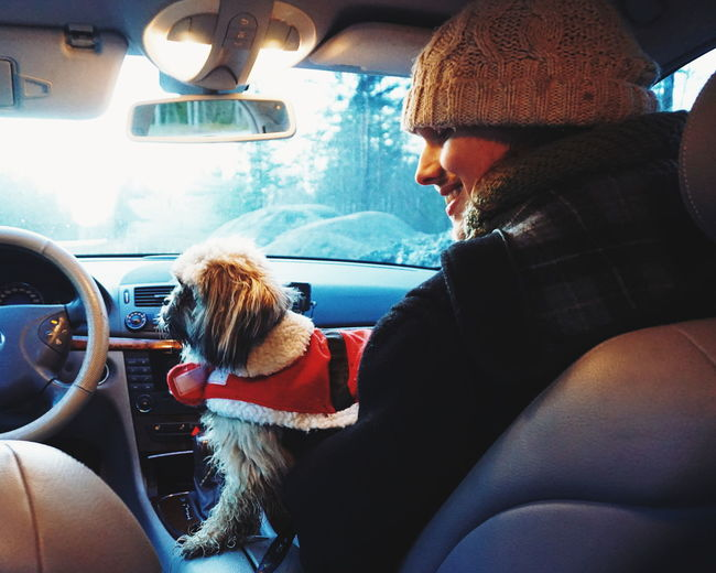 Traveling Home For The Holidays Car Car Interior Vehicle Interior Transportation Side View Sitting Travel Journey Dog Only Men One Animal People Adventure Warm Clothing Pets Animal Themes Close-up Cars Dogs Christmas Around The World Christmas