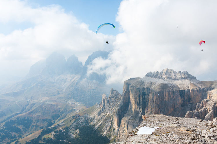 Flying...above Pordoi Adventure Extreme Sports Flying Freedom Leisure Activity Mid-air Mountain Mountain Peak Mountain Range Nature Non-urban Scene Outdoors Parachute Paragliding Scenics - Nature Sport