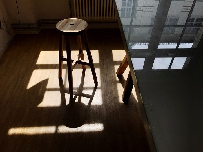 High angle view of table and chairs on floor