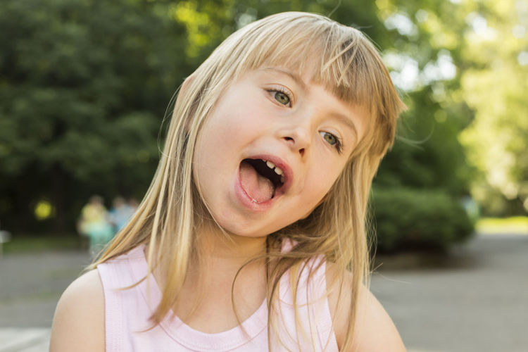 Close-up of girl with mouth open