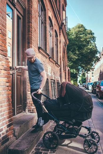 Man on street amidst buildings in city
