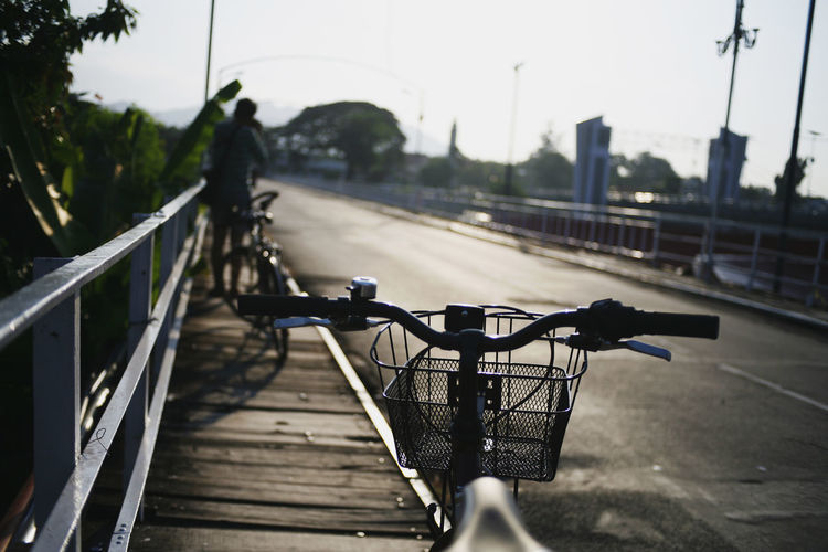 Bicycle Transportation Land Vehicle Mode Of Transportation Railing Focus On Foreground City Day Handlebar Bridge Nature Architecture Connection Road Metal Street Outdoors Footbridge Real People One Person Unrecognizable Person