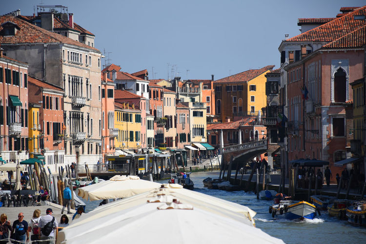 Canal, historic buildings, architecture, sunshine and chill in venice, italy