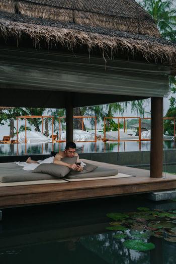 Man relaxing outside house