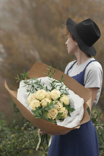 Hortensia Beauty In Nature Bouquet Bride Casual Clothing Close-up Day Florist Flower Flower Head Fragility Freshness Holding Leisure Activity Lifestyles Nature One Person Outdoors People Real People Rose - Flower Standing Wedding Dress Women Young Adult Young Women