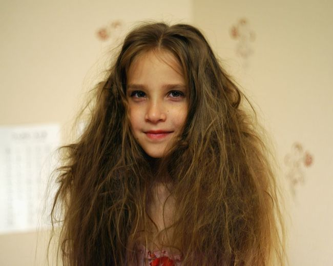 Portrait of girl with messy hair at home