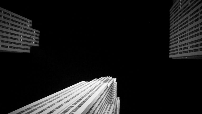 Looking up Architecture Architecture Architecturephotography Black And White Photography Blackandwhite Building Building Exterior Built Structure City Cityscape Clear Sky Illuminated Lookingup Low Angle View Monochrome New York City Night No People NYC Outdoors Skyscraper Skyscrapers Streetphotography Travel Destinations Minimalist Architecture Minimalist Architecture EyeEmNewHere