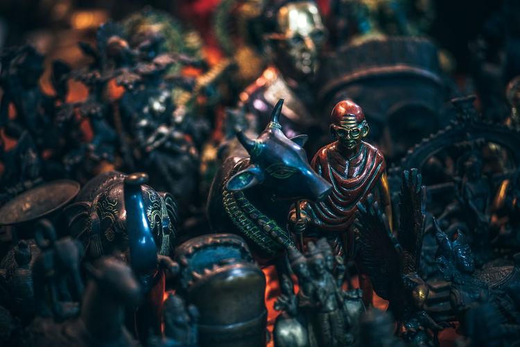 High angle view of figurines at market stall