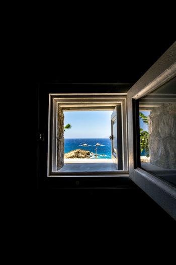 Architecture Blue Day Greece Indoors  Looking Through Window Nature No People Open Window Perspective Porthole Sea Sky Transportation Tree Window Windows