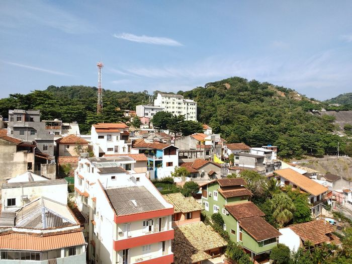 Cityscape of residential buildings and houses along a tropical forested hills. High Angle View House Tree No People Cloud - Sky Outdoors Day Sky Building Exterior Architecture Urban Jungle Brazilian Metropolis Cityscape Capital Cities  Tropical Latin America Urban Skyline South America Landscape Ecology Nature Meets Urban Scenics Nature Mountain