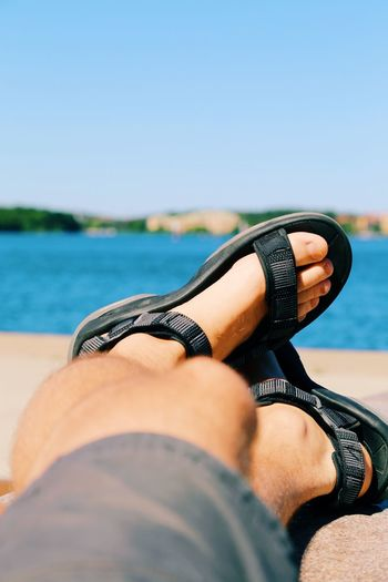 Summer Horizon Over Water Blue Sea Focus On Foreground Legs Crossed At Ankle Jetty View Feets Foot Feet Sandals Sandal Low Section Body Part Human Body Part Human Leg One Person Water Personal Perspective Lifestyles Sky Relaxation Sea Day Nature Human Limb Adult Leisure Activity Outdoors Real People Limb