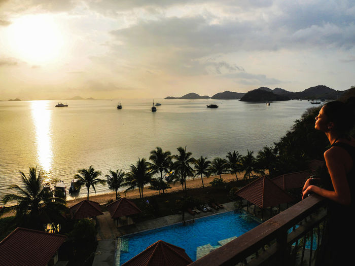 My friend is watching beautiful sunset. Beach Boats Girl Mountains Ocean Palms Pool Sea Sunset Watching Woman