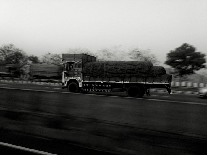 Transport vehicle Speed Truck Carrier Blackandwhite Highway Transportation Land Vehicle Outdoors Day No People Sky Black And White Photography Motion