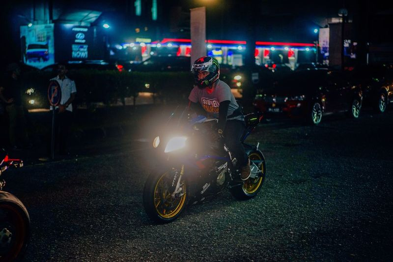 Born to ride Motorcycle Transportation Land Vehicle Street Night Mode Of Transport Illuminated Building Exterior Road Men Helmet Real People Riding Biker Full Length One Person City Architecture Built Structure Outdoors