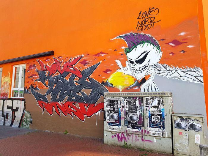 Graffiti on orange wall