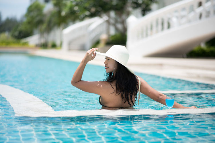 Adult Clothing Day Focus On Foreground Hairstyle Hat Leisure Activity Lifestyles Nature One Person Outdoors Pool Poolside Real People Sun Hat Swimming Pool Swimwear Water Women Young Adult Young Women
