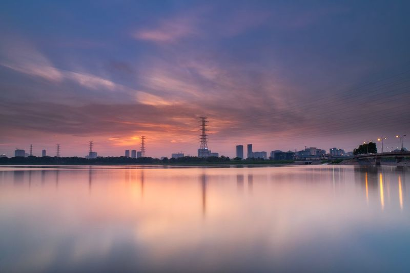 Sky Architecture Water Building Exterior Reflection Built Structure City Nature Industry Landscape No People Business Building Cloud - Sky Fuel And Power Generation Business Finance And Industry Sunset Environment Beauty In Nature Outdoors