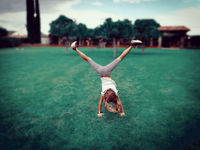 One Person Kid Girl Blonde Cartwheel Cart Wheels Kidsphotography Childhood Kids Being Kids People Outdoors Young Adult Day One Woman Only Only Women Grass Nature One Young Woman Only Close-up