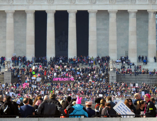 Protesters and signs gathered on the steps of the Lincoln Memorial at the Women's March in Washington, DC. A large sign calls for Donald Trump to be impeached. Lincoln Memorial Impeachment 2018 National Mall, Washington, DC Resistance  Washington, D. C. Adult Anti-Trump Protest Architectural Column Architecture Built Structure Crowd Day Large Group Of People Men Outdoors People Protesters Real People Sitting Travel Destinations Women Women's March