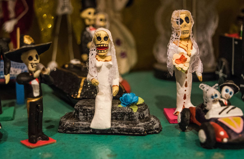 Skeleton sculptures on table at store